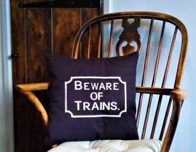 Black Beware of the Trains scatter cushion